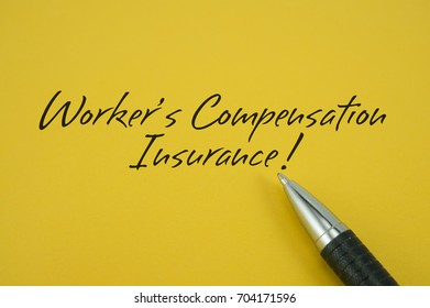 Worker's Compensation Insurance! note with pen on yellow background