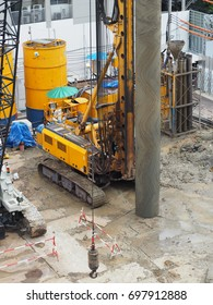 workers in construction area with crane truck and holding machine