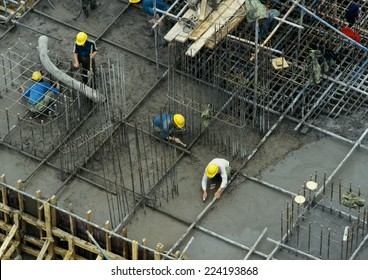 Workers in construction site, elevated view