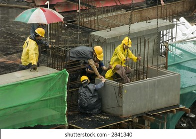 Workers at a construction site for high-rise residential apartment block