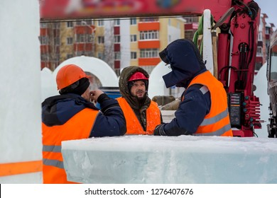 Workers at the construction site of the ice town for a conversation