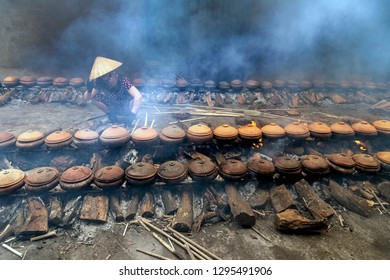 Workers cook fish with a clay pot. This is the famous method of processing fish of Vietnam.