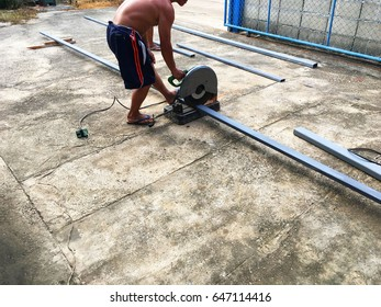 Workers are cutting steel with fiber cutter machine.