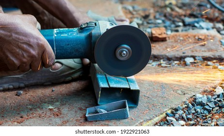 Workers are cutting steel pipes with fiber cutters in industrial work for home construction.