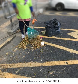 workers dump trash