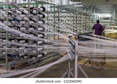 Workers, fiberglass mesh making machine, building materials for wall insulation