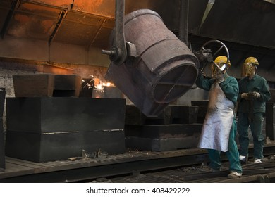 Workers with helmet inside a foundry