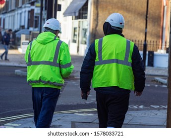 Workers with high visibility (hi-vis) vests and helmets.