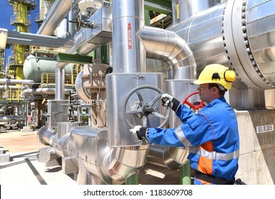 workers in an industrial plant for the production and processing of crude oil
