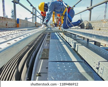 Workers are installing cable trays