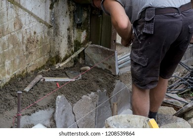 Workers at the laying and clipping of natural stone plates