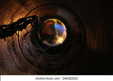 Workers are laying pipes at a construction site