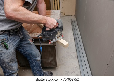 workers make repairs in the apartment