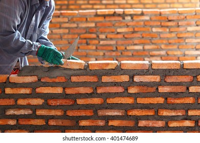 Workers masonry Clay brick to wall.
