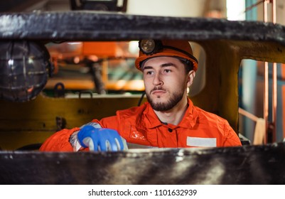 workers of the mining industry, to extract coal. repair of mine equipment. work in the mine. an engineer at the factory. repairs the mechanism. industrial enterprise.