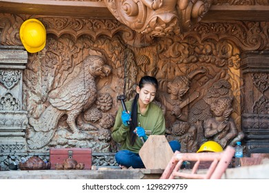 workers from Myanmar on wood carving work for the Wood Sanctuary of Truth Temple in the city of Pattaya in the Provinz Chonburi in Thailand.  Thailand, Pattaya, November, 2018