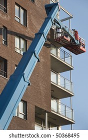 Workers on a aerial access platform