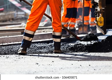 Workers on a road construction, industry and teamwork