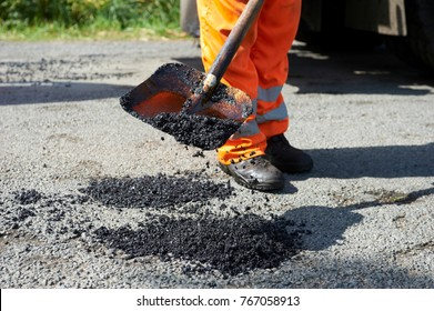 Workers on a road construction, industry and teamwork, new asphalt