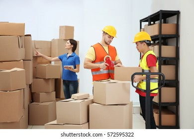Workers packing parcels at warehouse