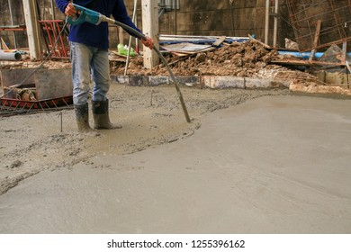 Workers are pouring concrete road.