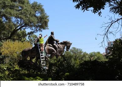 Workers prepare to remove Confederate statue in Robert E Lee Park, Dallas, Texas.