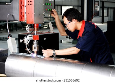 Workers in processing the solar water heater.2010 June shooting. In a Ningxia province China workshop production of solar water heater.