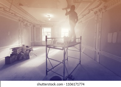 Workers  putty up ceiling walls in the room  in apartment is under construction, remodeling, renovation, extension, restoration and reconstruction. Image with tone and gradient effects