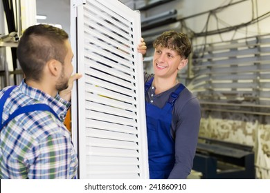 workers with  PVC window with shutter