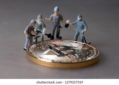 Workers repair golden virtual money coin. Miniature working people