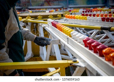 workers repair and paint the carousel in an amusement park