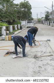 Workers are repairing cement roads.