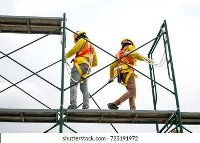 Workers  safety uniform on scaffolding,copy space.beautiful background in construction site