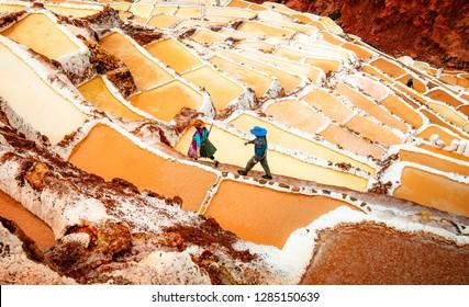 Workers at Salinas de Maras near Cusco, salt extraction in Peru