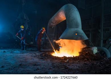 workers in steel factory metal industry