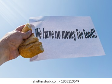 """Workers' strike for non-payment of salaries of wages. A worker holds in his hand a piece of bread and a banner, with the message """" We have no money for food"""""""