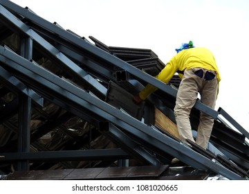 Workers are tiling roofs