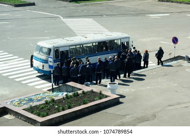 Workers in turnout coats get on the bus on the bus stop after day shift. Press-tour to the Chernobyl Nuclear Power Plant ChNPP for mass-media. April 20, 2018. Chernobyl, Ukraine