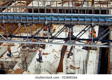 Workers in uniform at the construction site