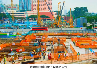Workers in uniform at urban construction site. Singapore