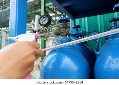 Workers use soap and water in the Foggy spray bottle injection to joints for check or inspection argon tank leaks test.