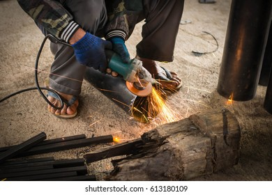 Workers use tools to cut steel in factories