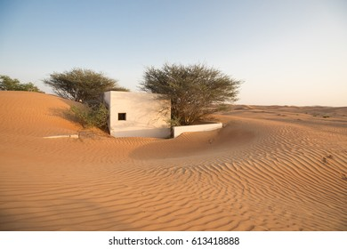 Workers village in Arabian desert abandoned in 1970s due to rumours of haunted houses. Dubai, United Arab Emirates.