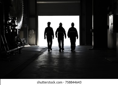 workers walking on power plant