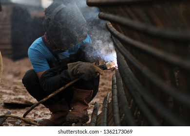 Workers weld the pole wire for the foundation of the Double-Double Track (DDT) project or the Manggarai-Jatinegara Package A double rail, Friday (04/21/17).