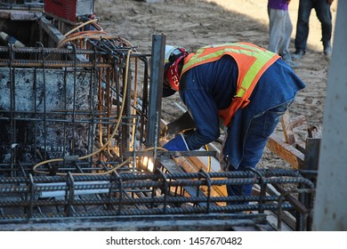 Workers are welding steel in the construction area.