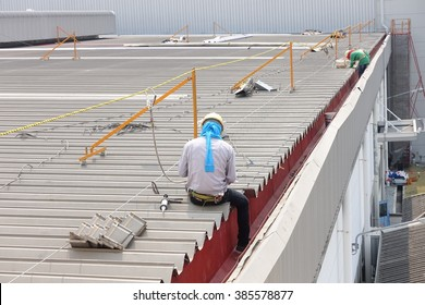 The workers were doing maintenance roof gutter.