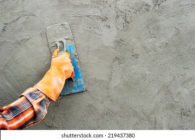 Workers were plastering.