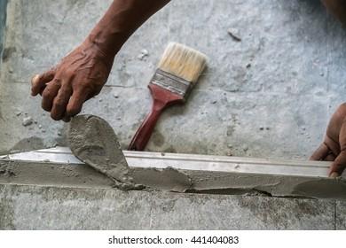 Workers were plastering - plaster concrete worker