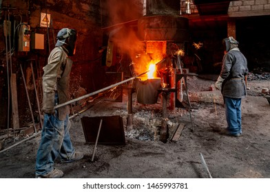 Workers who control the melting of metal in furnaces. Workers operate at the metallurgical plant. Where the liquid metal is poured into molds.